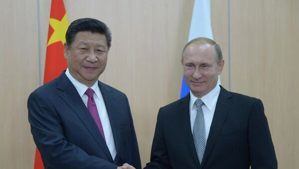 President of the Russian Federation Vladimir Putin (right) and President of the People's Republic of China Xi Jinping during their meeting in Ufa. - Sputnik International