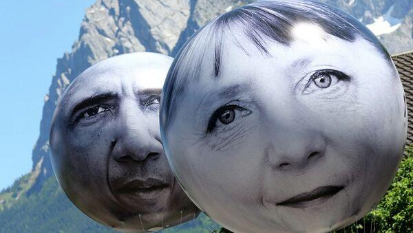 Balloons with the faces of German Chancellor Angela Merkel, left, and U.S. President Barack Obama - Sputnik International