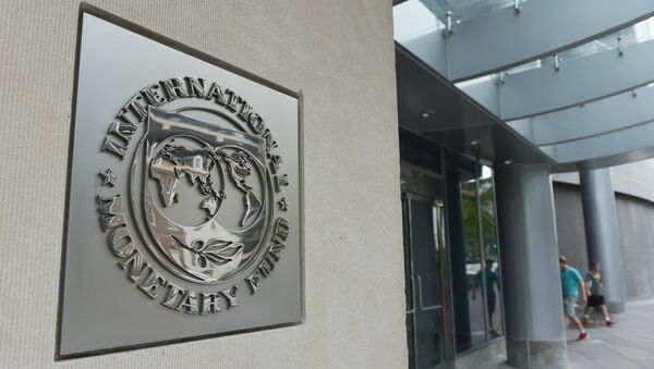 The seal of the International Monetary Fund is seen on a headquarters building in Washington - Sputnik International