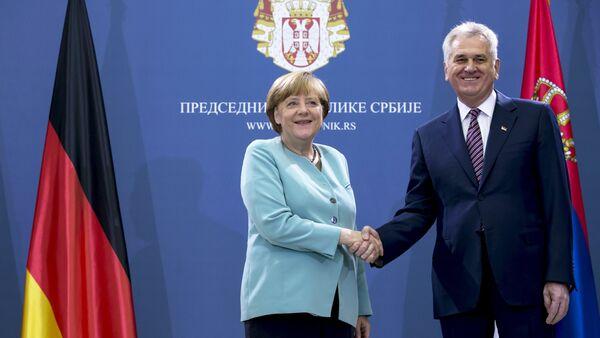 German Chancellor Angela Merkel shakes hands with Serbian President Tomislav Nikolic before their meeting in Belgrade, Serbia July 9, 2015 - Sputnik International