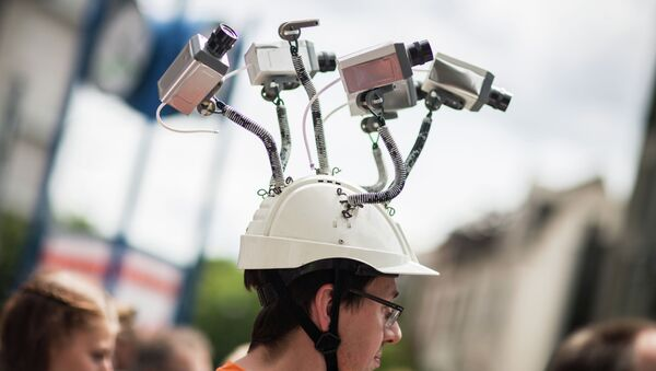 In this file photo dated May 30, 2015 Chairman of Hesse's Pirate Party Volker Berkhout wears a hat with mock surveillance cameras in Frankfurt am Main, central Germany - Sputnik International