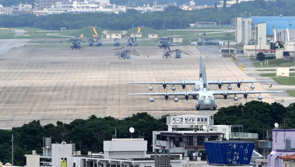 (FILES) A file picture taken on April 24, 2010 shows planes and helicopters stationed at the US Marine Corps Air Station Futenma base in Ginowan, Okinawa prefecture - Sputnik International