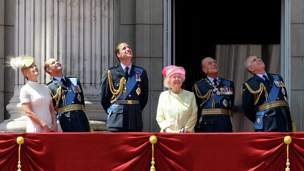 Britain's Queen Elizabeth II, fourth left, and from left, Sophie Countess of Wessex, Prince Edward, Prince William, her husband Prince Philip, and Prince Andrew watch a Royal Air Force flypast to mark the 75th anniversary of the Battle of Britain from a balcony at Buckingham Palace, in London, Friday, July 10, 2015. - Sputnik International