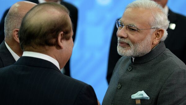 Indian Prime Minister Narendra Modi, right, speaks to Prime Minister of Pakistan Muhammad Nawaz Sharif, back to a camera, during the SCO (Shanghai Cooperation Organization) summit in Ufa, Russia, Friday, July 10, 2015 - Sputnik International