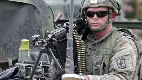 A US soldier takes part in an exercise called Saber Junction at the military area in Hohenfels near Regensburg, southern Germany, Monday, Sept. 8, 2014 - Sputnik International