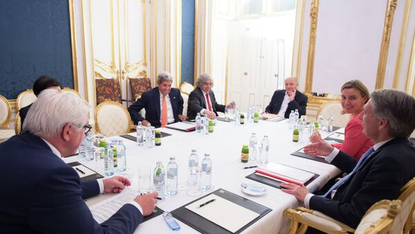 (L-R) German Foreign Minister Frank-Walter Steinmeier, US Secretary of State John Kerry, US Secretary of Energy Ernest Moniz, French Foreign Minister Laurent Fabius, the High Representative of the European Union for Foreign Affairs and Security Policy Federica Mogherini and British Secretary of State for Foreign and Commonwealth Affairs Philip Hammond (C) meet at the Palais Coburg Hotel, where the Iran nuclear talks are being held, in Vienna, Austria on July 14, 2015 - Sputnik International