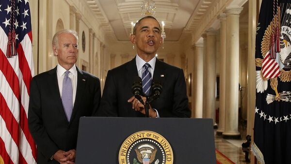 U.S. President Barack Obama speaks with Vice President Joe Biden at his side as he delivers a statement about the nuclear deal reached between Iran and six major world powers during an early morning address to the nation from the East Room of the White House in Washington, July 14, 2015 - Sputnik International
