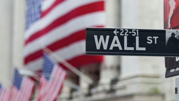 A Wall Street sign hangs near the New York Stock Exchange. - Sputnik International