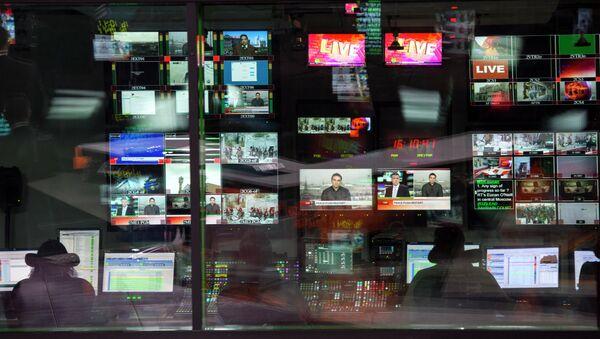 Control room of the Russia Today English-language newsroom - Sputnik International