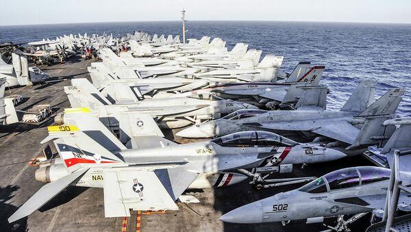 Aircraft line the flight deck of the aircraft carrier USS Ronald Reagan - Sputnik International