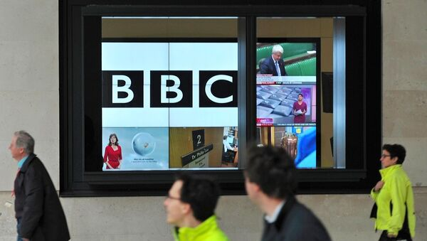 A BBC logo is pictured on a television screen inside the BBC's New Broadcasting House office in central London, on November 12, 2012. - Sputnik International