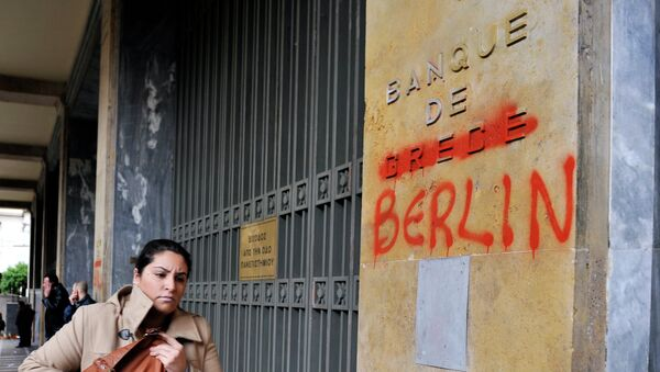 A woman passes by the Bank of Greece headquarters where 'Greece' was changed to 'Berlin' during a 24-hour general strike in Athens on February 7, 2012. - Sputnik International