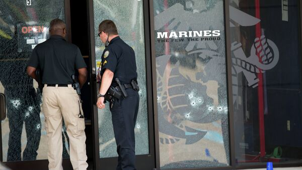 Police officers enter the Armed Forces Career Center through a bullet-riddled door after a gunman opened fire on the building Thursday, July 16, 2015, in Chattanooga, Tenn. - Sputnik International