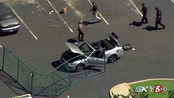 In this aerial image taken from video, law enforcement personnel work the scene of a shooting at the Navy Operational Support Center and Marine Corps Reserve Center Chattanooga Thursday, July 17, 2015, in Chattanooga, Tenn - Sputnik International