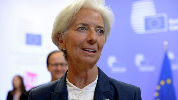 International Monetary Fund's (IMF) Managing Director Christine Lagarde talks to the media at the end of an Eurozone Summit over the Greek debt crisis in Brussels on July 13, 2015 - Sputnik International
