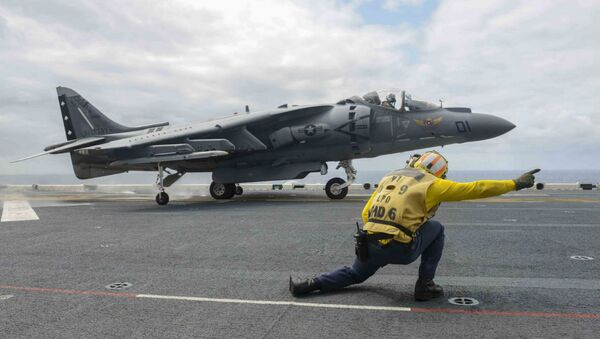 An AV-8B Harrier, assigned to the Marine Attack Squadron 231(VMA), takes off from the flight deck of forward-deployed amphibious assault ship USS Bonhomme Richard. - Sputnik International