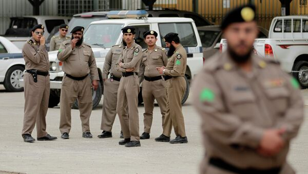 Saudi policemen form a check point near the site where a demonstration was expected to take place in Riyadh, Saudi Arabia, Friday, March 11, 2011 - Sputnik International