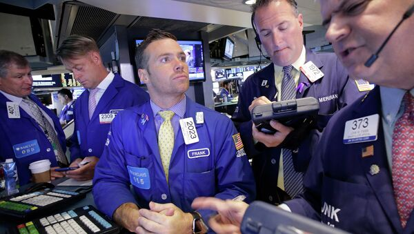 Traders Frank Masiello, center, and John Panin, right, talk about stock prices at the New York Stock Exchange, Tuesday, July 14, 2015 - Sputnik International
