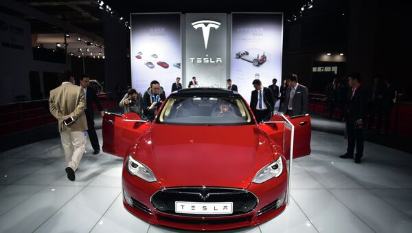 A Tesla Model S P85d car is displayed at the 16th Shanghai International Automobile Industry Exhibition in Shanghai on April 20, 2015 - Sputnik International