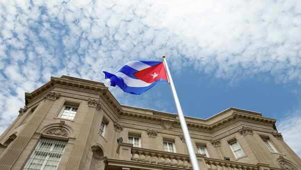 The Cuban flag is raised over their new embassy in Washington, Monday, July 20, 2015 - Sputnik International