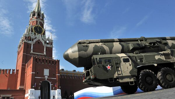 Russian Topol-M intercontinental ballistic missiles drive through Red Square during the Victory Day parade in Moscow on May 9, 2010 - Sputnik International
