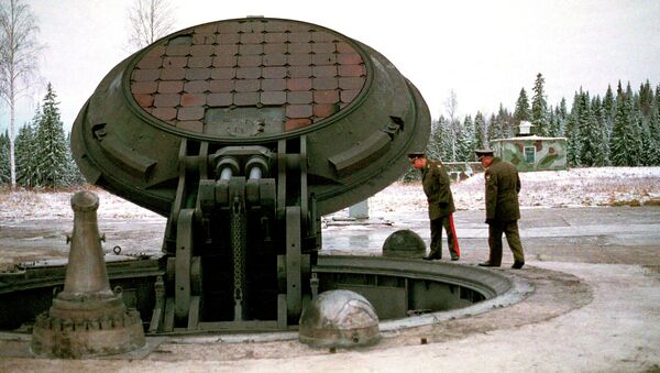 Russian high ranking military officials, look into an opened silo of a Russian intercontinental ballistic Topol-M missile somewhere at undisclosed location in Russia in this 2001 photo - Sputnik International