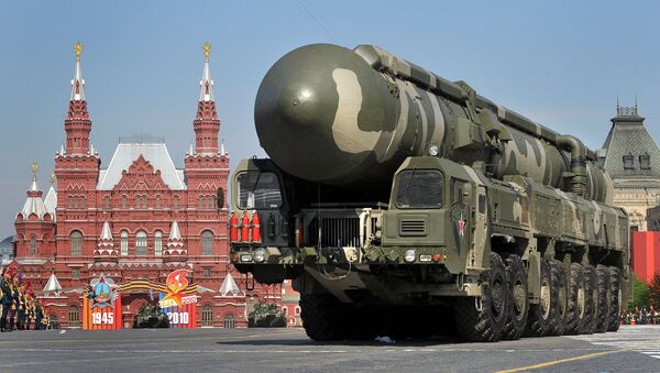 Russian Topol-M intercontinental ballistic missiles are paraded through Red Square on Victory Day in Moscow. File photo  - Sputnik International