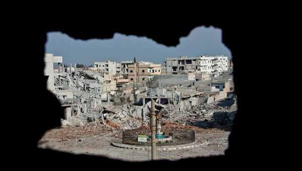 This Nov. 20, 2014 photo shows an area controlled by the Islamic State group, past the Qada Azadi roundabout, foreground, in Kobani, Syria. - Sputnik International