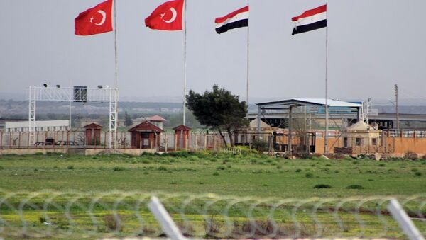In this photo taken Tuesday, April 10, 2012, the border crossing between Turkey and Syria is seen from a refugee camp near the border, in Kilis , Turkey. - Sputnik International