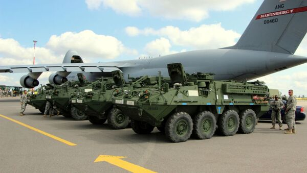 Elements from the Pennsylvania National Guard's 56th Stryker Brigade Combat Team arrive at Vilnius International Airport for participation in the multinational exercise Saber Strike 2014, June 7, 2014. - Sputnik International