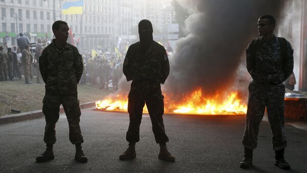 Tyres are set on fire during a rally held by members of the far-right radical group Right Sector, representatives of the Ukrainian volunteer corps and their supporters in central Kiev, Ukraine - Sputnik International