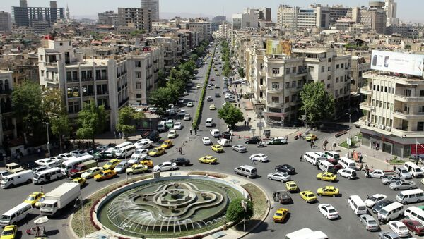 A general view shot taken on June 30, 2015, shows traffic on a roundabout in the Syrian capital Damascus - Sputnik International