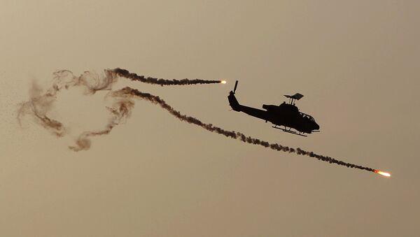 A Cobra attack helicopter fires diversionary flares. - Sputnik International