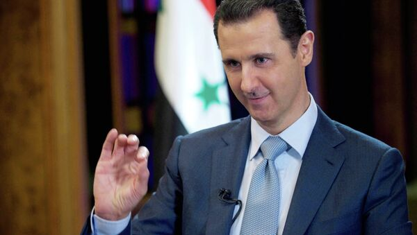 In this Tuesday, Feb. 10, 2015 file photo released by the Syrian official news agency SANA, Syrian President Bashar Assad gestures during an interview with the BBC, in Damascus, Syria - Sputnik International