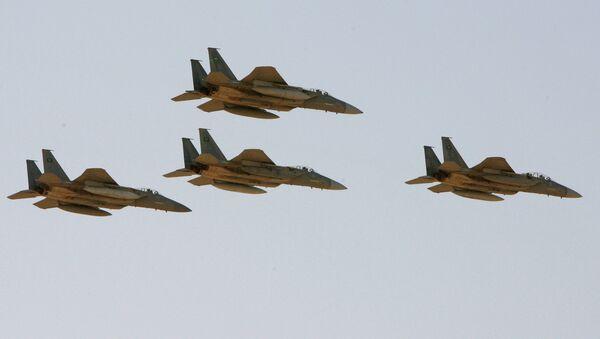F-15 warplanes of the Saudi Air Force fly over the Saudi Arabian capital Riyadh during a graduation ceremony at King Faisal Air Force University - Sputnik International