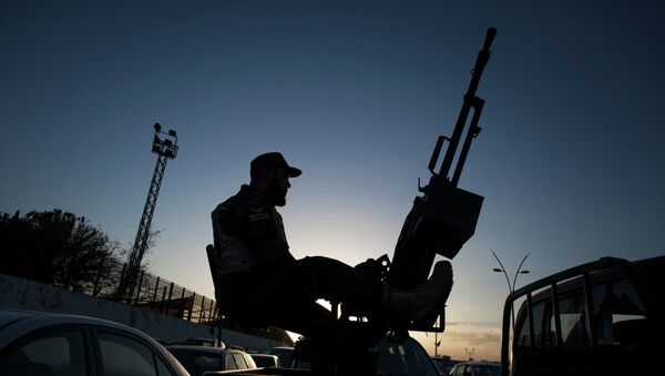 A Libyan army soldier stands guard sitting on an antiaircraft truck during the handover of the Nawaseen military compound, which was the headquarters of Libyan militias, in Souk al-Juma district, Tripoli, Libya - Sputnik International