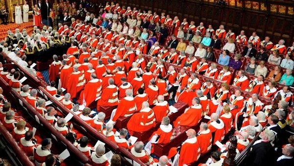 Britain's Queen Elizabeth, rear centre left, delivers her speech at the State Opening of Parliament, in the House of Lords in London Wednesday May 8, 2013.  - Sputnik International