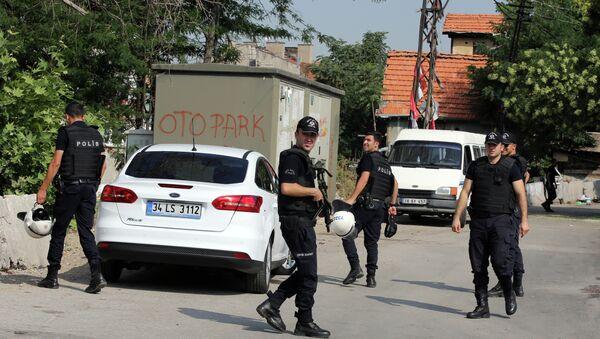 Police officers patrol as Turkish police raide homes in Haci Bayram neighborhood in the capital Ankara, Turkey, Monday, July 27, 2015 - Sputnik International