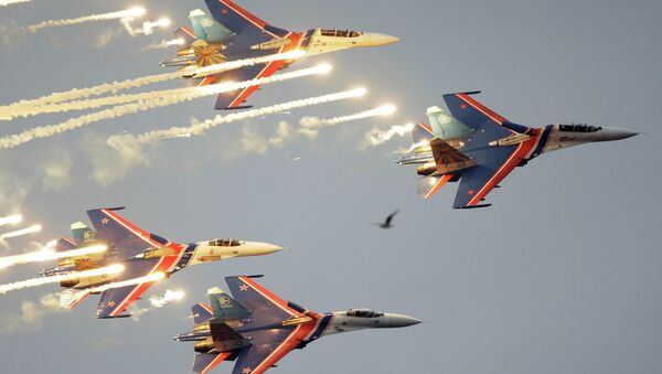 Russian Knights aerobatic team of four Su-27 jet fighters performing at  a MAKS international air show. file photo - Sputnik International