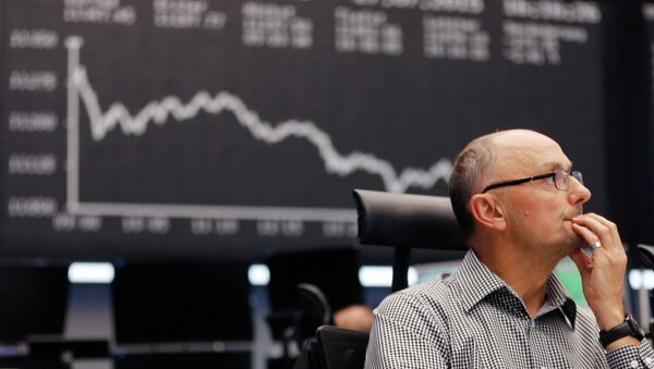 A trader watches his screens at the stock market in Frankfurt, Germany - Sputnik International