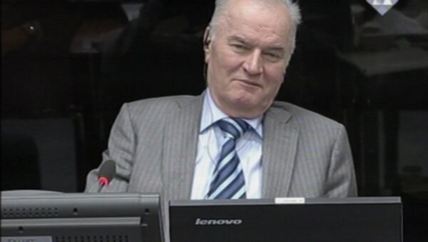 In this image taken from video former Bosnian Serb army commander Gen. Ratko Mladic smiles during his appearance at the Yugoslav war crimes tribunal Tuesday Jan. 28, 2014 in the Hague Netherlands - Sputnik International