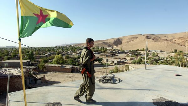 A Kurdistan Workers Party (PKK) fighters guards a post flying the PKK flag. File photo - Sputnik International