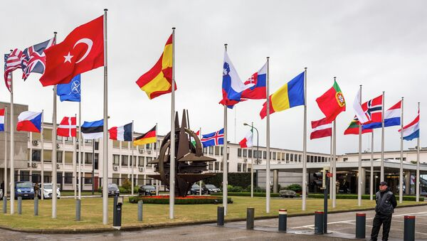 NATO country flags wave outside NATO headquarters in Brussels on Tuesday July 28, 2015. - Sputnik International