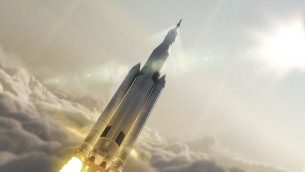 Artist's concept showing the 77-ton configuration of NASA's Space Launch System rocket launching into space. - Sputnik International
