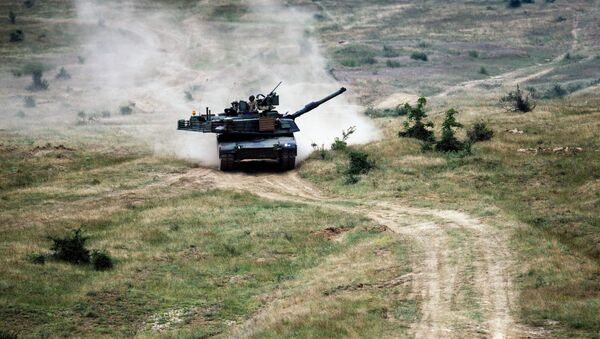 US Army M1A2 Abrams battle tank is pictured during a joint military drill in Latvia - Sputnik International