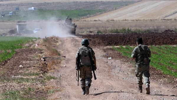 Turkish soldiers patrol near the border with Syria, ouside the village of Elbeyli, east of the town of Kilis, southeastern Turkey - Sputnik International