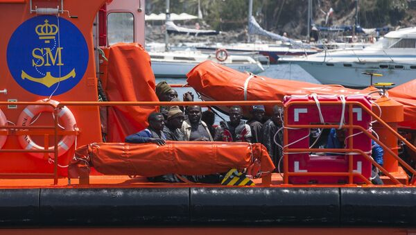 African migrants rest on board a Spanish rescue boat after arriving at Arguineguin port in the Canary Island Gran Canaria, Spain, July 13, 2015 - Sputnik International