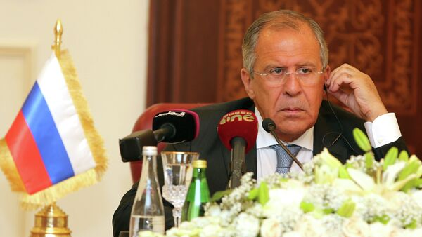 Russia's Foreign Minister Sergey Lavrov listens during a joint press conference with Qatari Foreign Minister Khalid bin Mohammad Al-Attiyah (unseen) on August 3, 2015 in Doha - Sputnik International