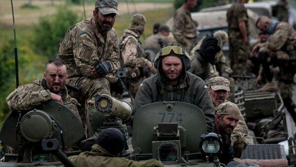 In this photo taken Tuesday, July 14, 2015, Ukrainian servicemen ride atop an armored vehicle near Krasnoarmiisk, Donetsk region, eastern Ukraine - Sputnik International