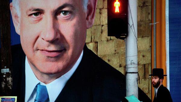 An Israeli ultra-orthodox Jewish man walks past an election campaign billboard of Israeli Prime Minister and Likud Party leader Benjamin Netanyahu, in Bnei Brak, near Tel Aviv, Israel, Sunday, Jan. 6, 2013. - Sputnik International